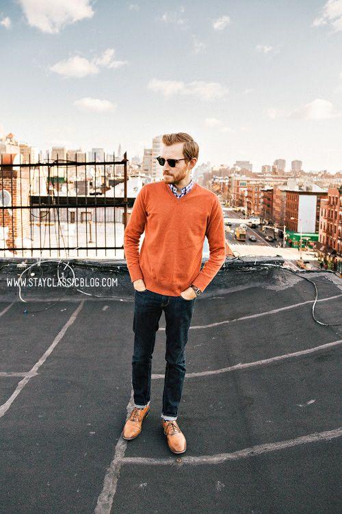 Orange sweater, brown shoes.