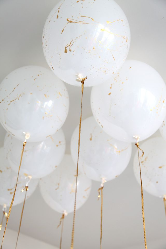 MadeByGirl: My 2nd Birthday Party, gold splatter balloons with gold ribbon DIY
