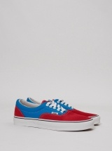 vans. i really like these i got a pair today same colors but the body is entirely blue w/red laces white outline sole like above and a red bottom :)