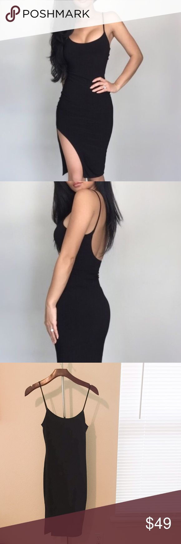 EkAttire Black Strappy Dress With Side Slit. New with tag. In excellent condition. The beautiful Elaine is the one modeling this sexy dress. I love it but I never reach for it and I really need to clean out my closet. Flattering fit. No trades. No PayPal. Price is firm unless bundled. ekAttire Dresses