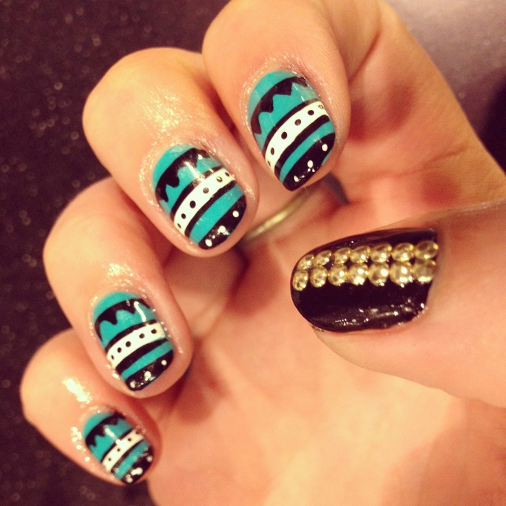tribal aztec nail art design in turquoise white and