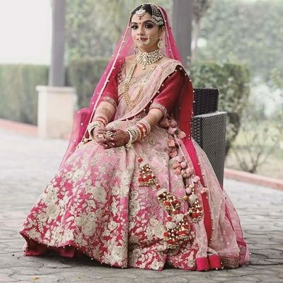 Bridal Lehengas - Bride in an Ombre Lehenga with Gold Dull Embroidery | WedMeGood #wedmegood #indianbride #indianwedding #bridal #indianlehenga #bridal #pompoms #ombre