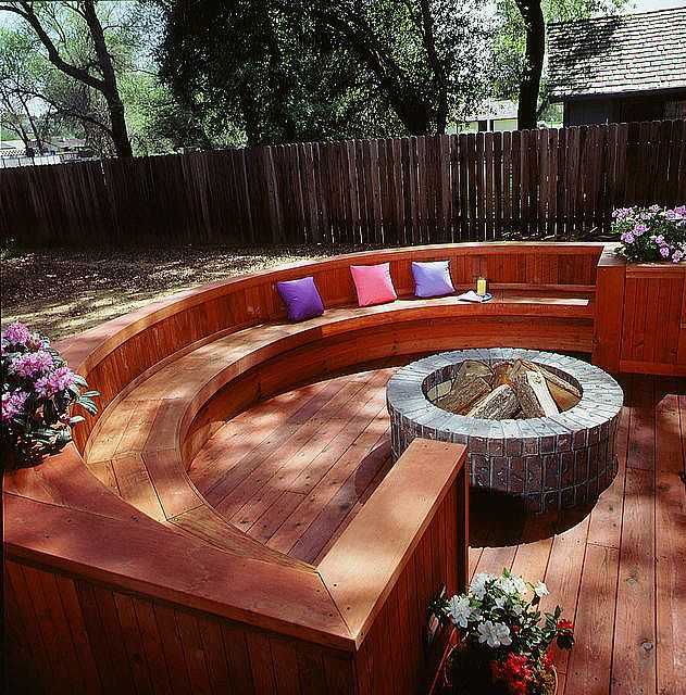 Redwood deck with large seating area and built in fire pit for Built in fire pits designs