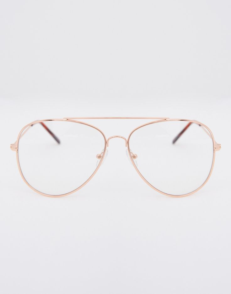 Add a little mystery with these cool Aviator Clear Glasses. Celebs like Kendall have mastered this trend and we are in love. These glasses come in multiple colors and feature an aviator shape with a t
