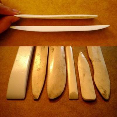 Bone folders. Mine is made of teflon, but there's something really appealing about the traditional tool.