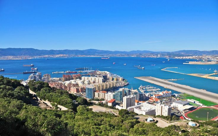 Travelers landing in Gibraltar can marvel over a vista that spans two continents and three countries, with North Africa, Spain, and the nearly 1,400-foot-tall Rock of Gibraltar all on display.