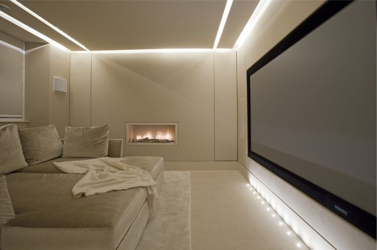 Home cinema in the lower ground floor of a private house in Knightsbridge by Lawson Robb