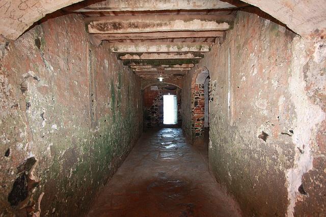 Walkway to the door of no return slave dungeon goree for Door of no return