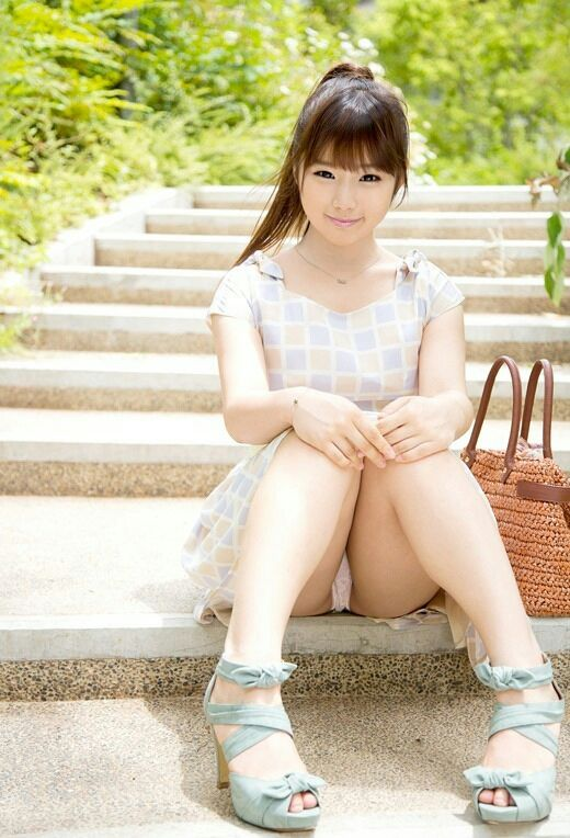 Lovely asian girl on the stairs in the park and wears nice plaid dress #asiangirl