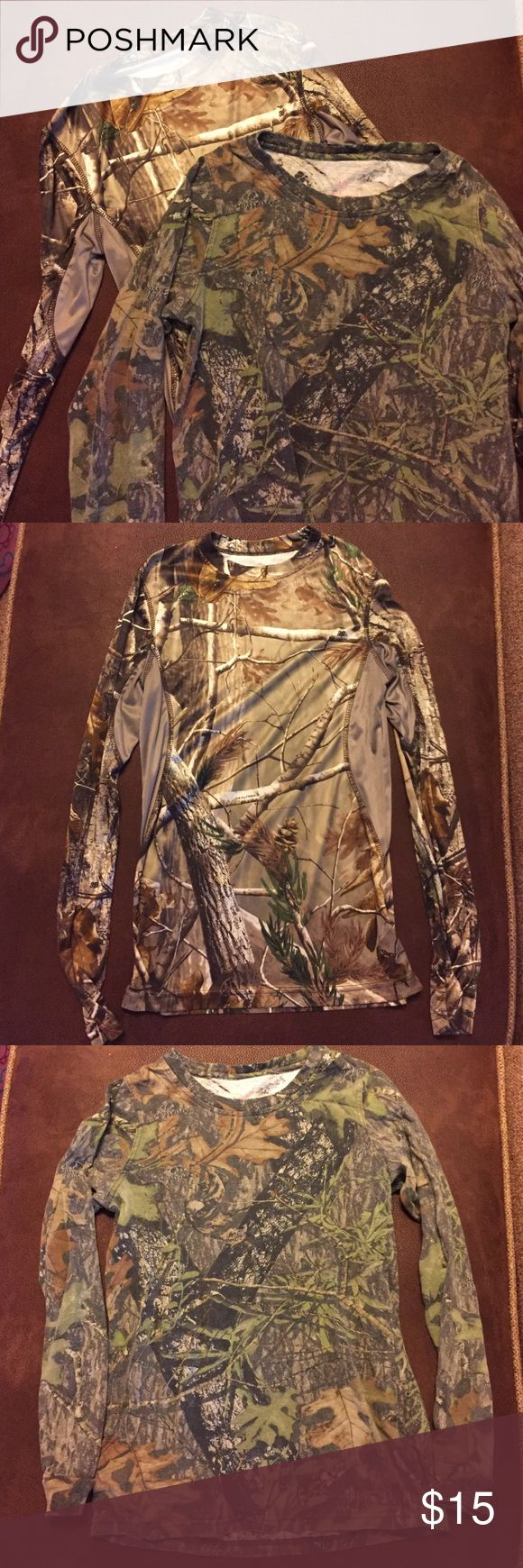 Bundle of camo shirts Great condition! Bundle of woman's camo long sleeve shirts. Size small. One is 100% cotton and one is 100% polyester. Brand Game Winner. Tops Tees - Long Sleeve