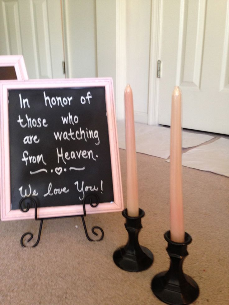 I spray painted thrift store candle holders black and found a shimmery light pink candles for them. The frame is spray painted light pink and the glass is sprayed with chalkboard paint to create the chalkboard dedication sign for my light pink and black wedding. DIY wedding decorations. Black and light pink wedding and reception