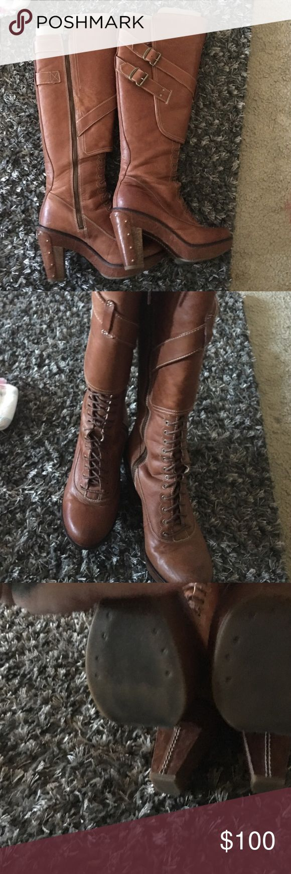 ⭐️SALE⭐️ USED TIMBERLAND KNEE HIGH BOOTS USED bought from a fellow posher and is a bit tight for my calves. Well haven't really tried to undo the laces as it has give and should fit a range of sizes. Said was only used a couple of times. It is in excellent condition and very high quality. Has zipper and laces. Size 7 and true to size Timberland Shoes Lace Up Boots