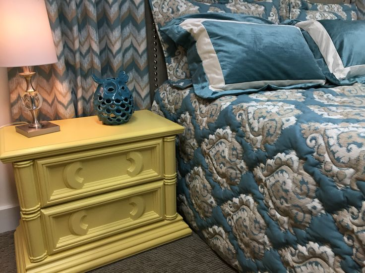 Custom bedspread with outline quilting to make the design pop, coordinated wave drapes and a great bed side table painted in farrow and ball yellow ground