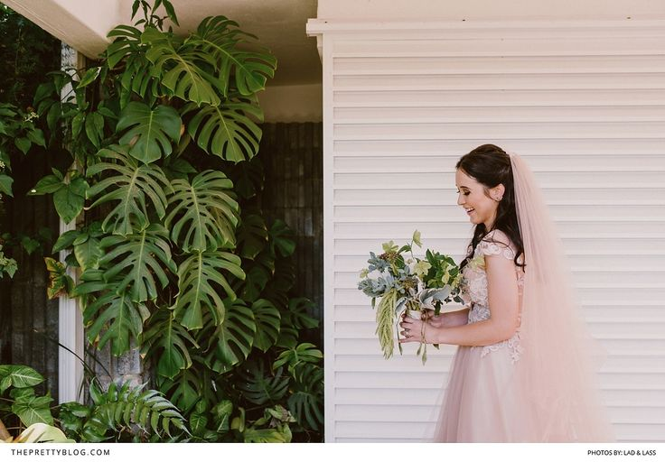 Our bride, Dani and her green bouquet. Photo by Lad & Lass
