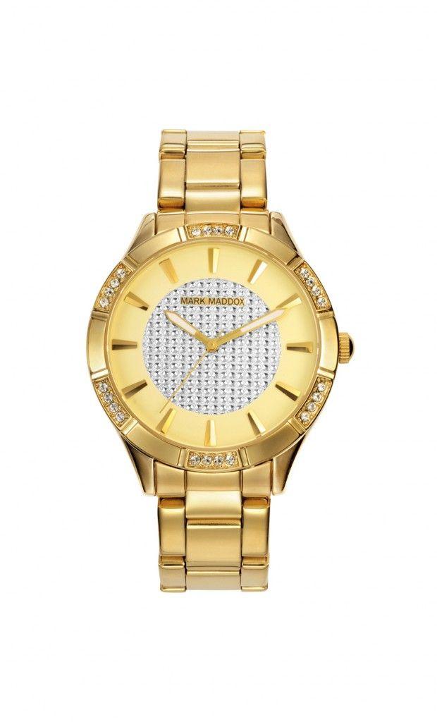 Un reloj moderno y con mucho glamour.  Reloj tres agujas brazalete con incrustaciones en el bisel y cierre desplegable. Cristal mineral e impermeable 30m (3ATM).