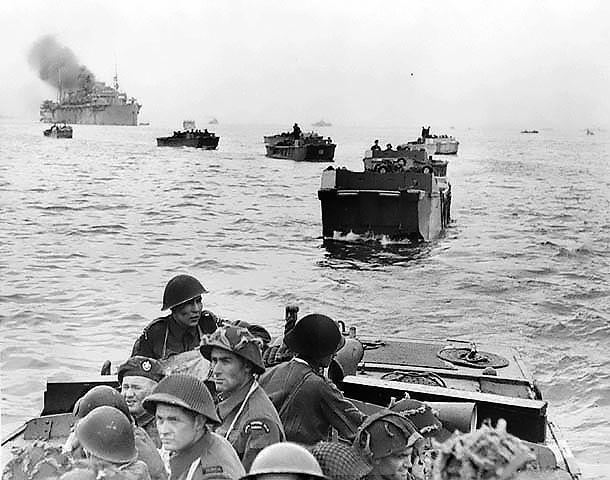 Troops of the Canadian Royal Winnipeg Rifles regiment approaching Juno Beach, Normandy, France aboard LCA landing craft, 6 Jun 1944