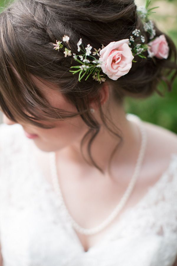 Loose updo with a braid and flowers,