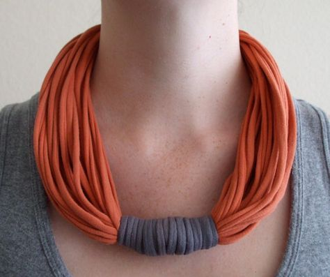Colors: Orange and gray Material: T-shirts Our accessories are made from repurposed t-shirts (cotton & spandex) that have been washed and made into unique pieces. This necklace is reversible and can be worn with the gray binding in front, on the side, or in back. Its three necklaces in one! Our necklaces are handmade, one of a kind and super original. The length and thickness will change from piece to piece. For all of you mothers out there...our necklaces are the best accessory if...