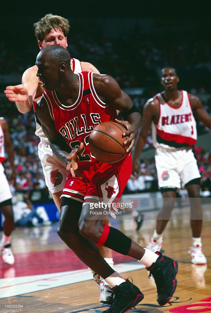 Michael Jordan #23 of the Chicago Bulls drive on Danny Ainge #9 of the Portland Trail Blazers during the 1992 NBA Finals June 1992 at Memorial Coliseum in Portland, Oregon. The Bulls won the NBA Championship 4 game to 2. Jordan played for the Bulls from 1984-93 and 1995 - 98.