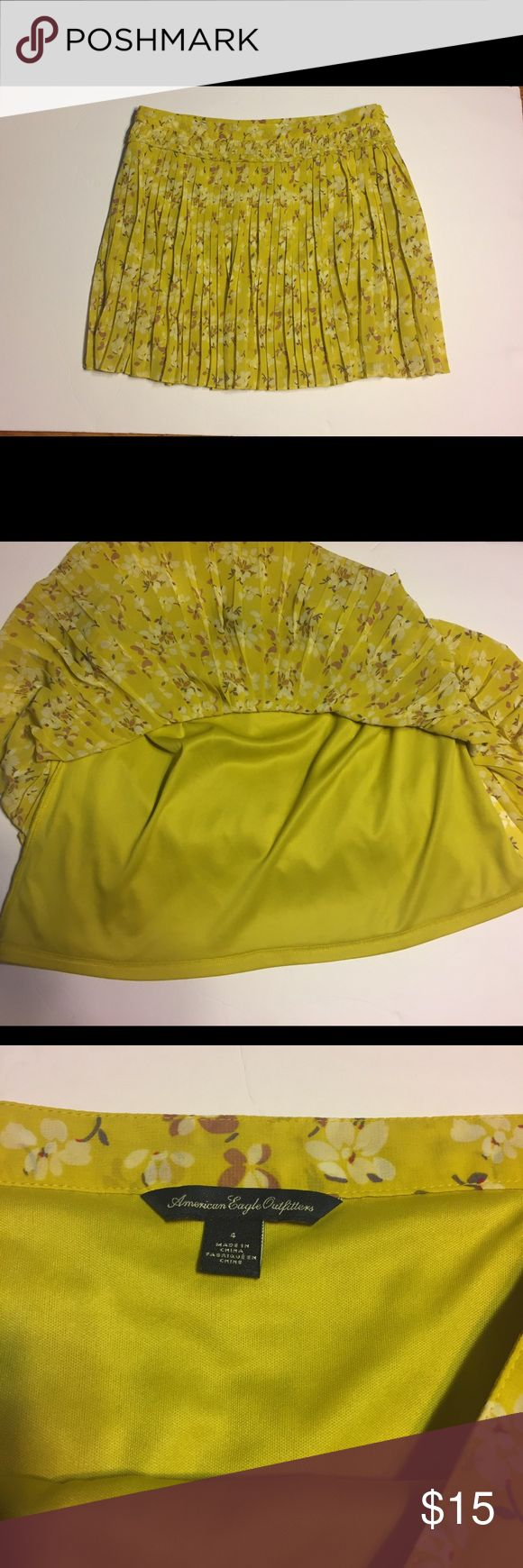 American Eagle yellow floral pleated skirt SZ4 Cute little American Eagle Outfitters pleated lined yellow floral mini skirt SZ:4, waist:14, length:14 1/2 Preowned no rips stains or holes. American Eagle Outfitters Skirts Mini