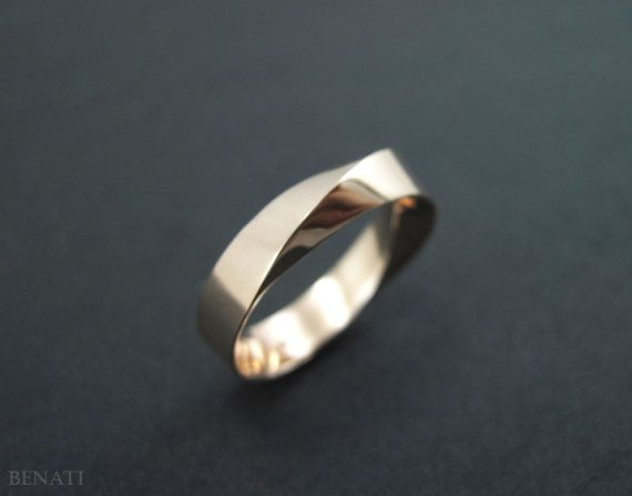 Exclusive to Benati.    Solid 14k gold Mobius ring, made to perfection in approx. 6mm width (~0.23). A beautiful, unique and meaningful symbol on your