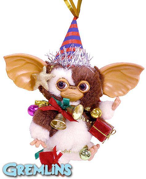 Peluche Gizmo Navidad, 13 cms Peluche Gizmo el bueno, vestido con adornos de navidad, muy propio para estas fiestas, que hará la delicia de grandes y pequeños.