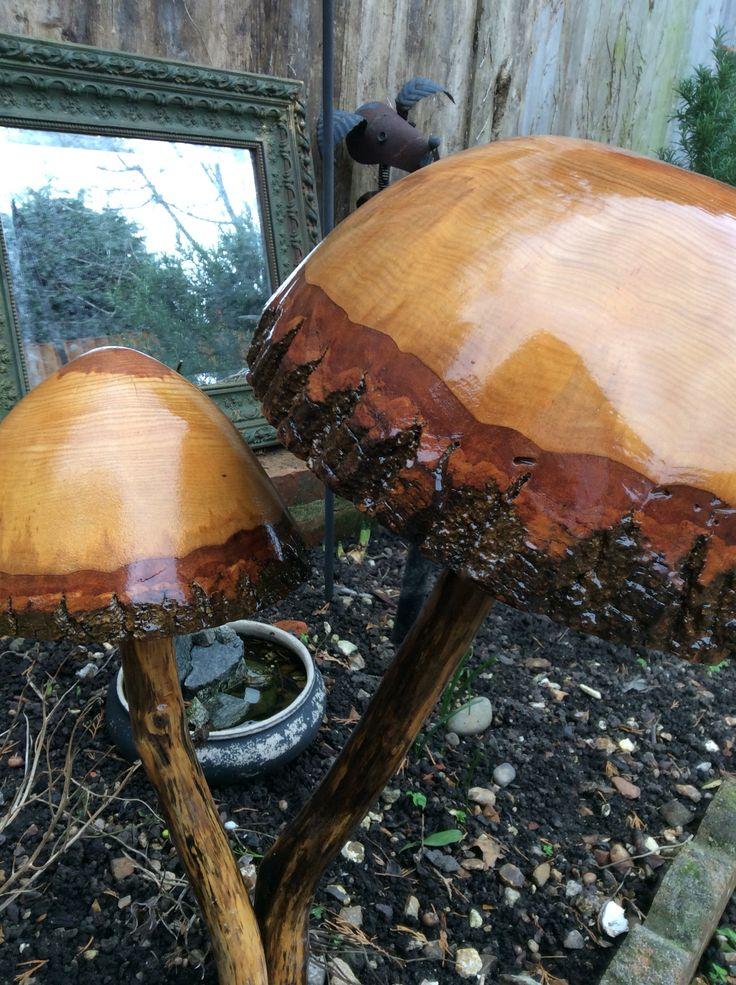 Wooden garden toadstool sculptures