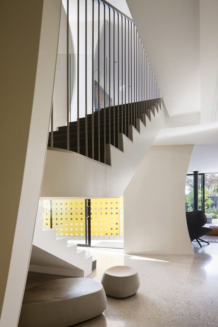 The stairway is seemingly suspended in mid air above the living room below