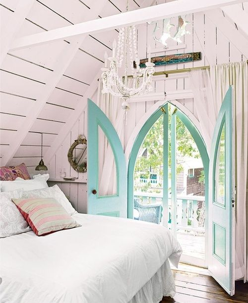 It's beautiful and cozy at the same time with the gorgeous door letting so much of the outdoors in, it makes a small room feels much larger. I'd never want to leave this room...I love it all, it's romantic, shabby chic decor and how light and airy it is.