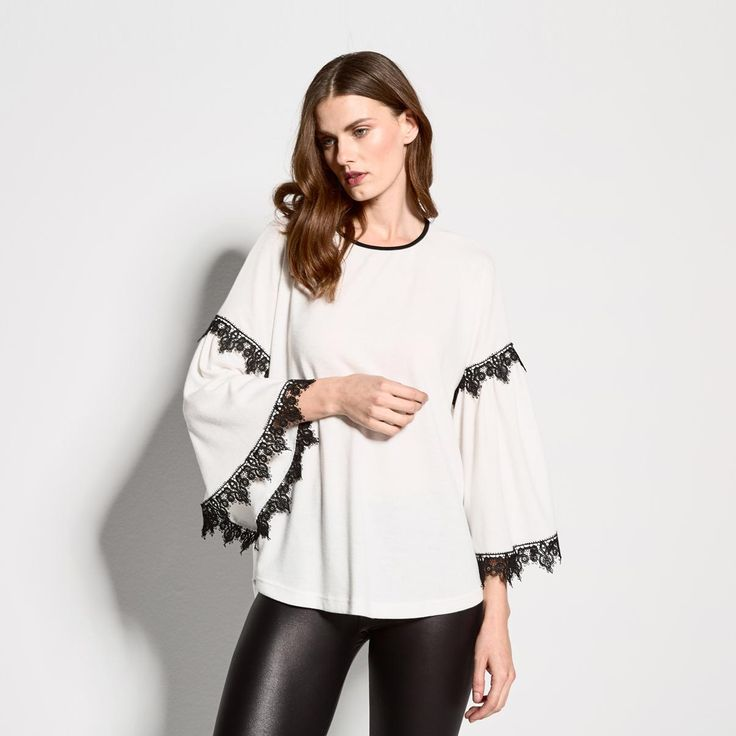 Top with lace details on sleeves