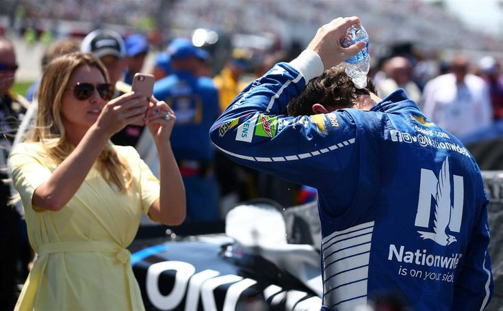 Richmond weekend:    Sunday, April 30, 2017  -    Dale Earnhardt Jr., driver of the No. 88 Nationwide Chevrolet, pours water over himself as his wife Amy documents it prior to the Monster Energy NASCAR Cup Series Toyota Owners 400 at Richmond International Raceway on April 30, 2017 in Richmond, Virginia.  -    Photo Credit: Getty Images  -    Photo: 7 / 59