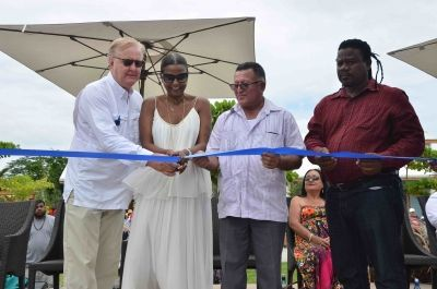Ribbon-cutting - From left, Colin Murphy, #Norwegian Cruise Line Holdings; Kim Simplis Barrow, wife of Belize Prime Minister Dean Barrow; Tourism Minister Manuel Heredia; Edmond Castro, minister of state for National Emergency Management - First cruise ship calls at new Belize destination, Harvest Caye