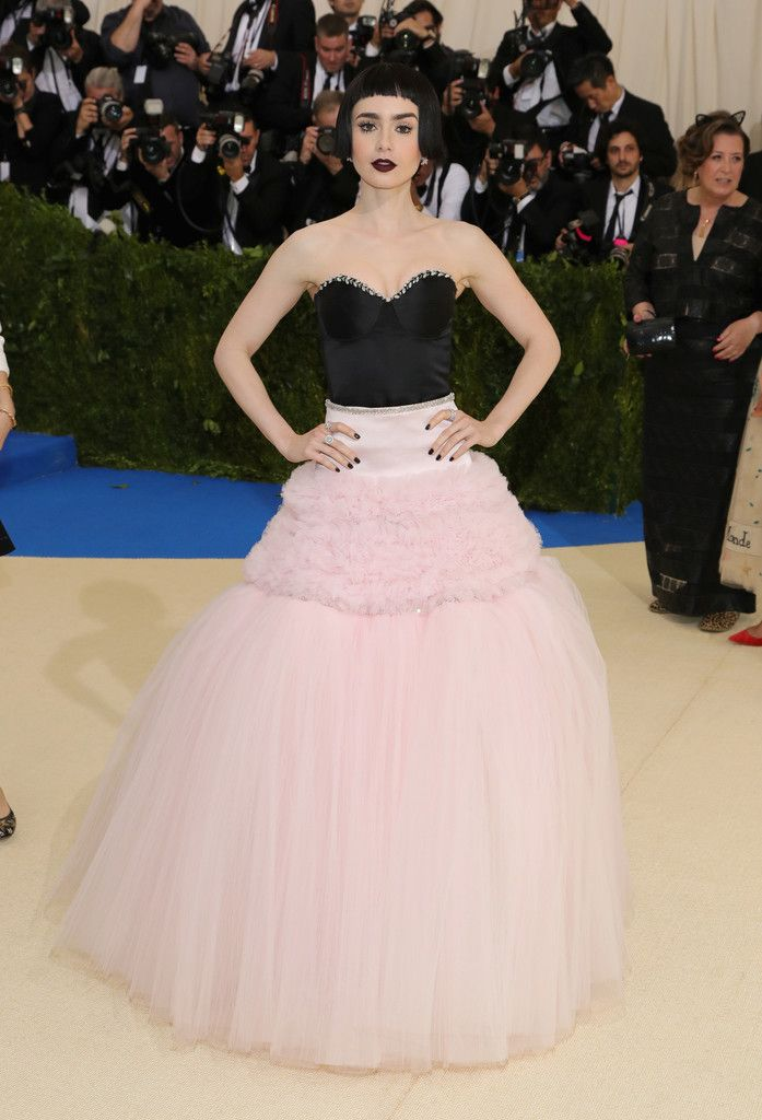 Lily Collins Strapless Dress - Lily Collins hovered between sweet and edgy in this strapless black and pink ball gown by Giambattista Valli Couture at the 2017 Met Gala.