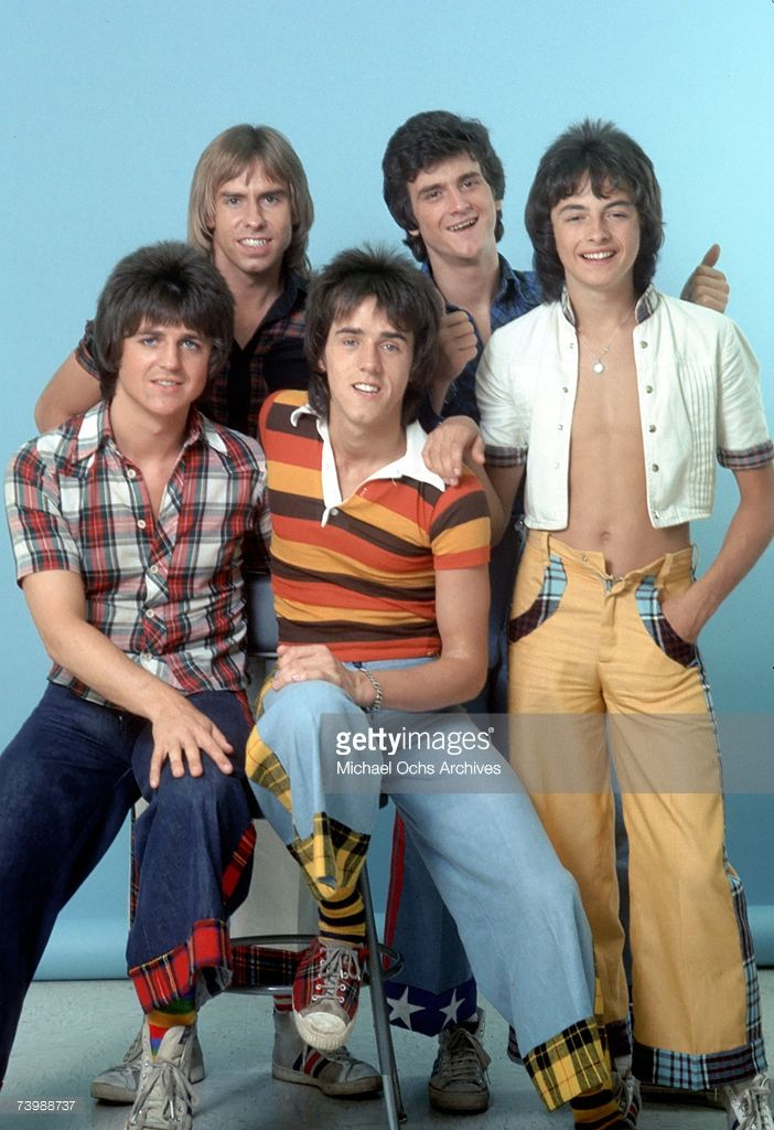 Scottish rock band 'The Bay City Rollers' pose for a portrait in December 1978 in Los Angeles, California. (L-R back) Derek Longmuir, Leslie Mckeown and Ian Mitchell, (L-R front) Eric Faulkner and Stuart 'Woody' Wood.