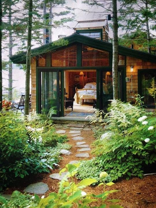 Beautiful tiny house in the woods with green trim. Love the stepping stones, the plants along the path, and the open feeling. (Picture only)