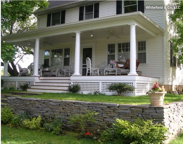 Love the porch and lattice underpinning.. Stacked rock wall