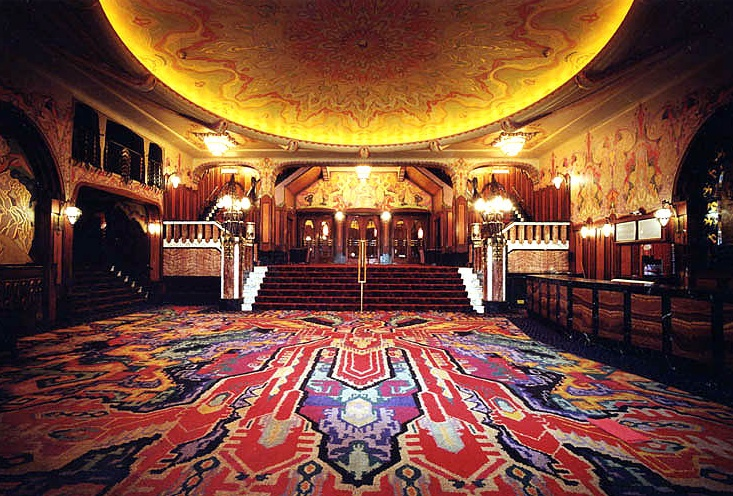 Tuschinski movie theater in Amsterdam. If there is a movie you want to see this is the place to be. The building is amazing. The architecture is timeless. And sitting in a loveseat makes it even more special.