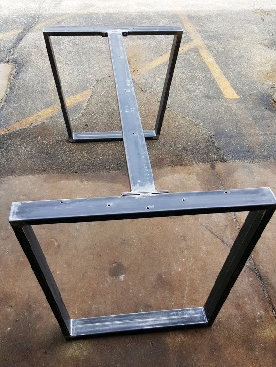 This listing is for set of 2 Trapezoid Tubing Legs with 1 or 2 Braces Dimensions is 28 H x 28 W x 70 L - Made from 3 x 1 Steel Tubing. 14 gauge (.075) wall. There is 2 options: 1. With 1 Brace - center on the top 2. With 2 Braces on both sides on the top - finish : raw steel, clear coat, black flat There are dimensions H (height) and W ( top width)