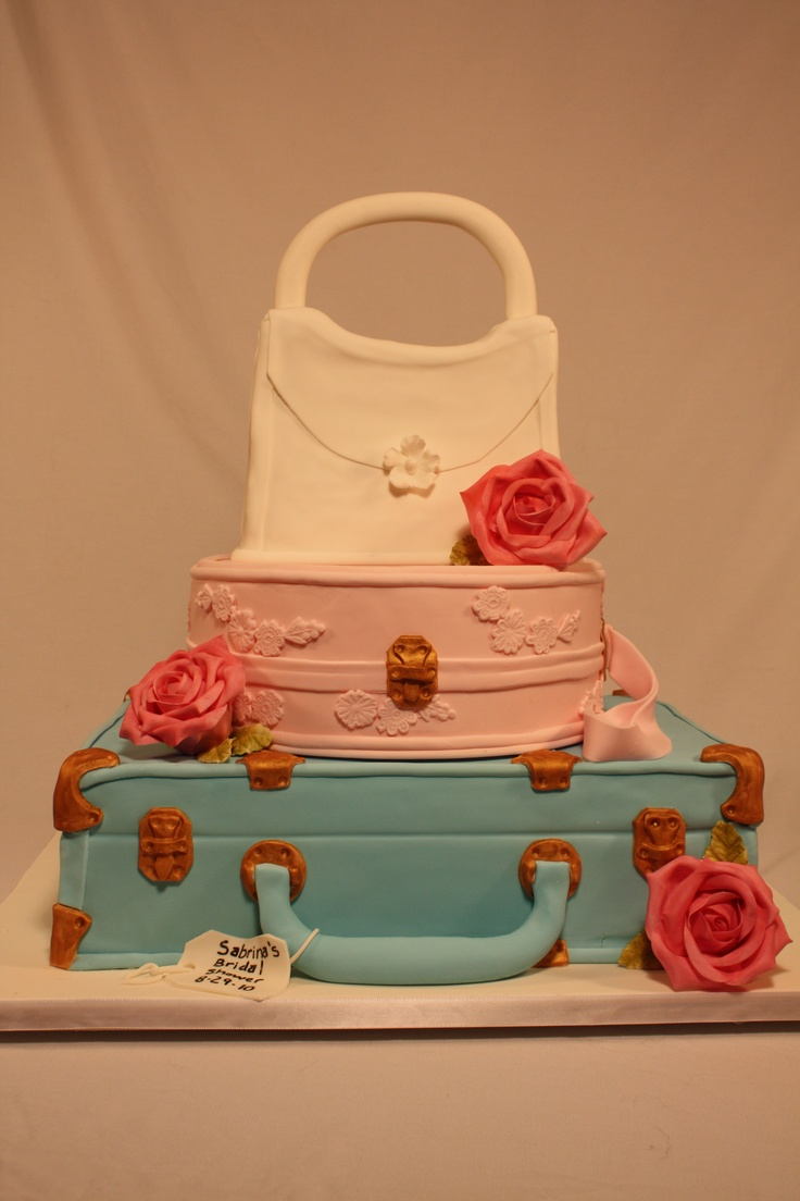 Suitcase cake - Bridal shower suitcase cake. Bride gave me a picture of the cake she wanted and I went off of the picture unfortonately do not know who made the original.