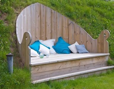 Roomy bench fitted into a hillside nook.