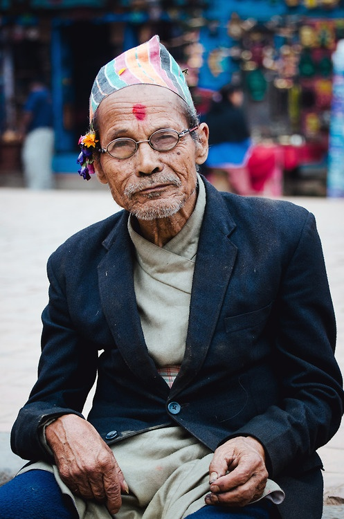 A well-dressed Nepali Hindu stands out in the bustle old-town Bhaktapur.