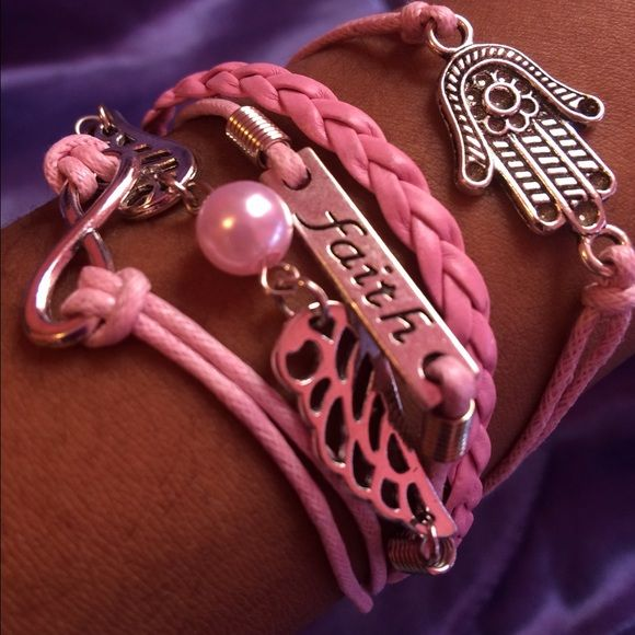 🆕 Pink Bracelet A brand new pink colored bracelet. Has a infinity sign, hand with flower, wings, and says faith. Jewelry Bracelets