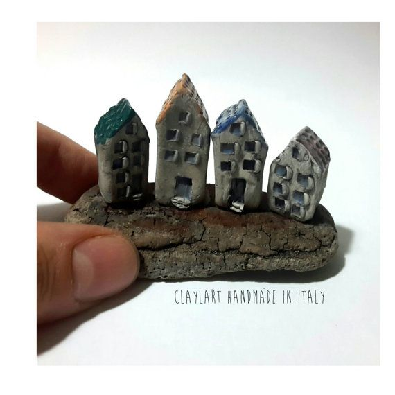 Ceramic miniature houses on a recicled sea wood by claylart handmade in italy https://www.etsy.com/it/listing/468194396/scultura-in-ceramicavillaggio-case-in