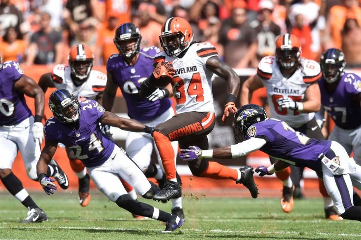 Cleveland Browns running back Isaiah Crowell (34) breaks away from Baltimore Ravens free safety Lardarius Webb, right, and cornerback Shareece Wright (24) to score a touchdown in the first half of an NFL football game, Sunday, Sept. 18, 2016, in Cleveland.