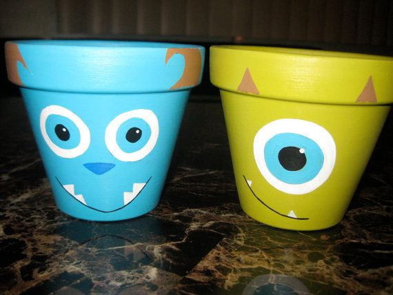 Hand painted Sully and Mike Wazowski garden pots set Disney/Pixar on Etsy, $29.99