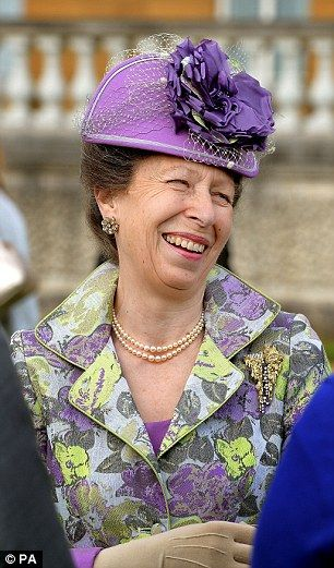 The Princess Royal talks to guests during the Buckingham Palace Garden Party, 28 May 2015. Yes, this is the same outfit she wore to William and Kate's wedding in 2011.