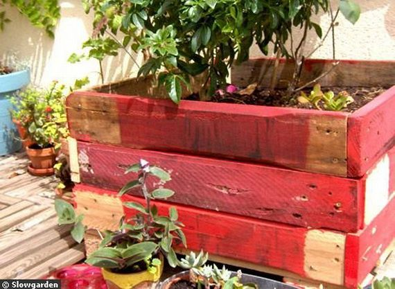 Small Balcony Design Ideas_09  Love the red wood box to hold plants. So cute