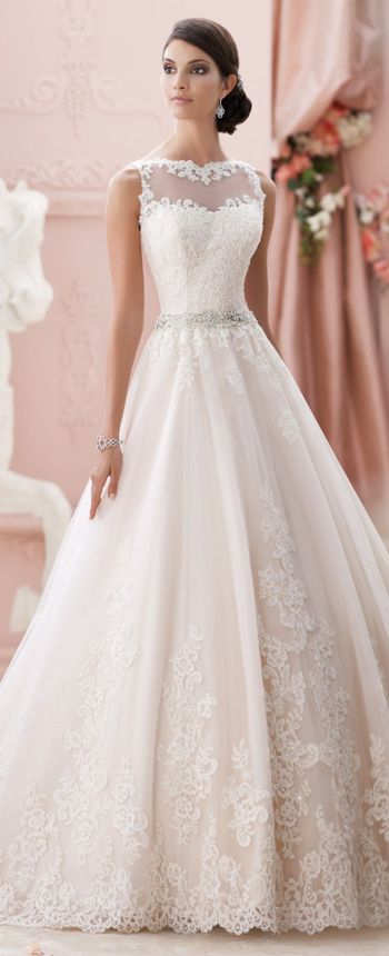 This illusion neckline wedding dress features sleeveless corded lace and tulle over luxurious satin, intricately beaded waistline, and a tulle skirt.