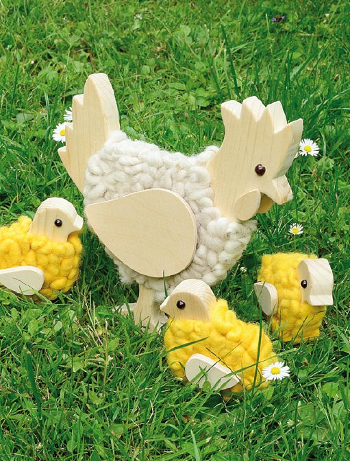 Wollige Frühlingsboten aus Holz - Henne mit Hühnern