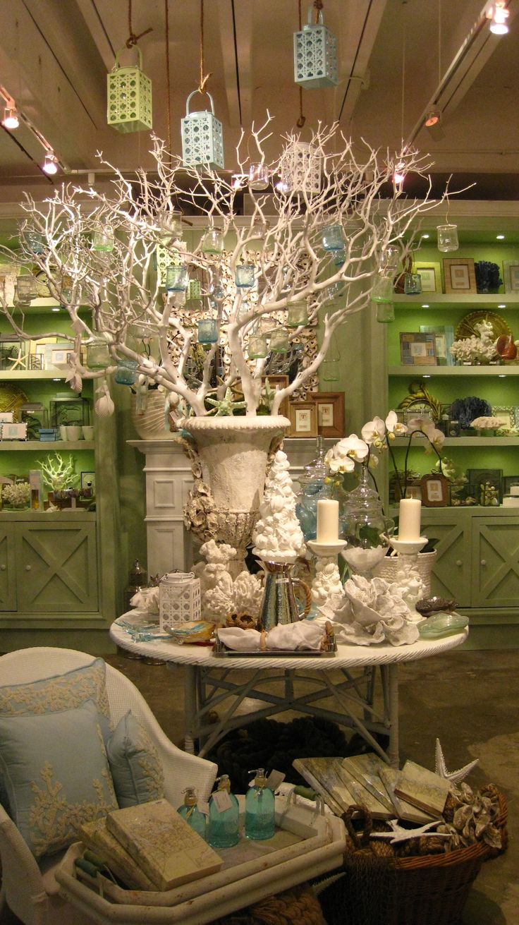 For a Christmas display, get out the flat white spray paint, and layer.  Inspiration, this beautiful display - love the urn with branches